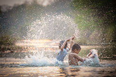 Children  playing in the river Stock Photography