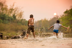 Children  playing in the river. Asian boy and girl playing in the river Royalty Free Stock Photo