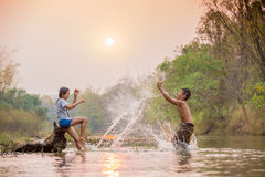 Children  playing in the river. Asian boy and girl playing in the river Stock Image