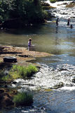 Children playing in a   river Royalty Free Stock Photo