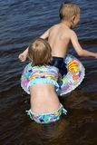 Children playing in the river. Sister and brother playing in the river Royalty Free Stock Photos