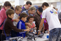 Children playing with robots Stock Photography