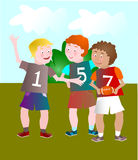 Children playing outside rugby. Children playing rugby outdoors Stock Images