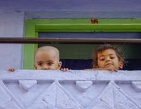 Children playing at rural house stock image