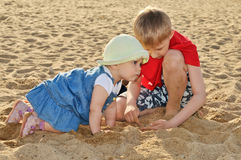 Children playing with sand Stock Photo