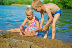 Children playing in the sand Royalty Free Stock Photo