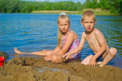 Children playing in the sand Stock Photography