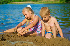Children playing in the sand Royalty Free Stock Image
