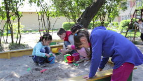 Children playing in the sand kindergarten stock video footage