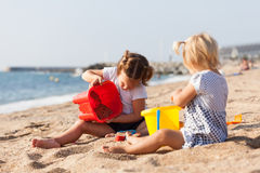 Children playing with sand Royalty Free Stock Image