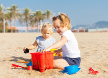 Children playing with sand Stock Image