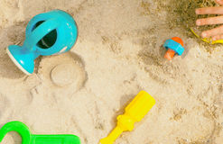 Children playing sandbox colorful toys. Top view Royalty Free Stock Image