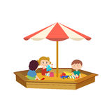 Children playing in the sandbox on the playground, communicate. Royalty Free Stock Image