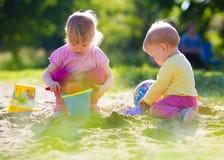 Children playing in sandbox Royalty Free Stock Photos