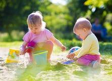 Children playing in sandbox Royalty Free Stock Photo