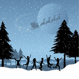 Children playing with santa in the sky Stock Photos