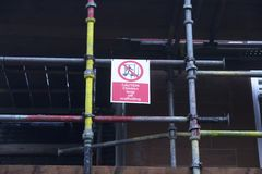 Children playing on scaffold not allowed safety sign at construction building site royalty free stock photography