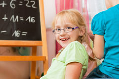 Children playing school. Children – sisters - playing school in their room Royalty Free Stock Photos