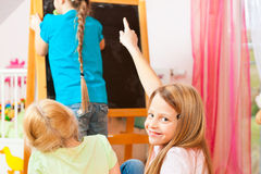 Children playing school at home Stock Photos