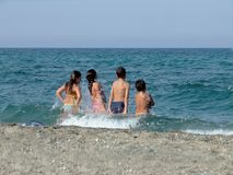Children playing in sea. With the waves Royalty Free Stock Image