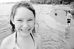 Children playing at seashore Stock Photos