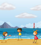 Children playing at the seashore Stock Photography