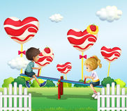 Children playing with the seesaw in the playground. Illustration of the children playing with the seesaw in the playground Royalty Free Stock Photos