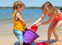 Children Playing on Shore Stock Image