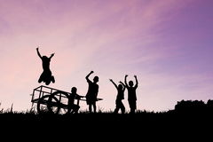 Children playing silhouette on color of sky Royalty Free Stock Images
