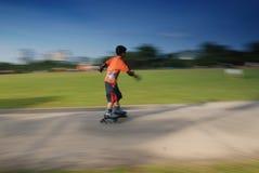 Children playing skating royalty free stock image