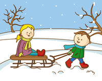 Children playing with a sled in the snow Royalty Free Stock Images