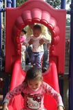 The children playing on the slide Royalty Free Stock Photos