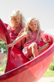 Children playing in slide in the playground royalty free stock photos