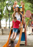 Children playing on sliding toy Royalty Free Stock Photography