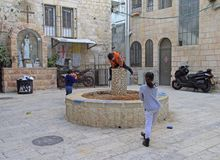 Children are playing on small square of Jerusalem Royalty Free Stock Photography