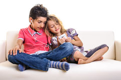 Children playing smartphone Royalty Free Stock Images