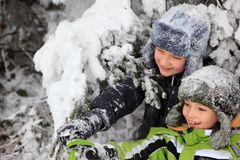 Children playing in snow Stock Photos
