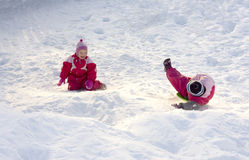 Children playing in the snow. Children (2-3 years old) playing happily in the snow Royalty Free Stock Image