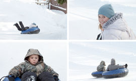 Children playing in snow. Young boy and his sister having a great time on the slopes in a snow tube Royalty Free Stock Photography