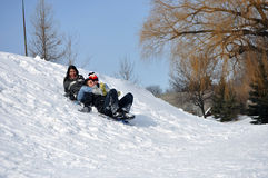 Hispanic Children Playing in the Snow Stock Photography