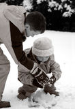 Children playing in the snow Stock Images