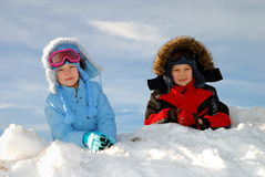 Children playing in snow Stock Photo