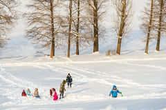 Children Playing With Snow After Snowfall On Winter Day In Tineretului Park Of Bucharest. BUCHAREST, ROMANIA - JANUARY 11, 2017: Children Playing With Snow After Stock Image