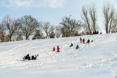 Children Playing With Snow After Snowfall On Winter Day In Tineretului Park Of Bucharest. BUCHAREST, ROMANIA - JANUARY 11, 2017: Children Playing With Snow After Stock Photography
