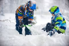 Children playing in the snow, Ukraine, Mukachevo. December 2016 Stock Photos
