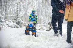 Children playing in the snow, Ukraine, Mukachevo. December 2016 Stock Image