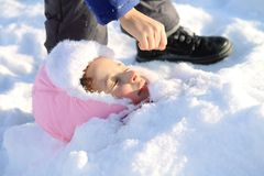 Children playing in the snow. In winter royalty free stock photo