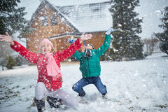 Children playing on snow in winter holiday Stock Photography