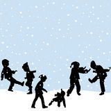 Children playing in the snow Royalty Free Stock Photo