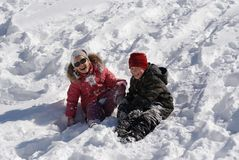 Children playing in snow. At winter vacation Stock Images